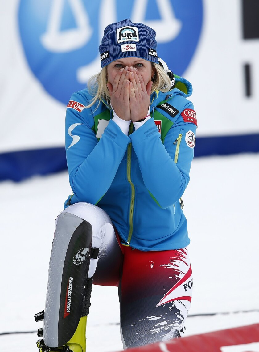 Nicole Hosp, of Austria, reacts after winning the women's World Cup slalom ski race Sunday, Nov. 30, 2014, in Aspen, Colo. (AP Photo/Alessandro Trovati)