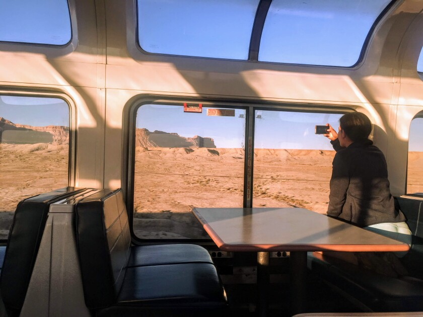 Passenger Erica Hendry takes photos of the Utah desert from her seat in the observation car of the California Zephyr.