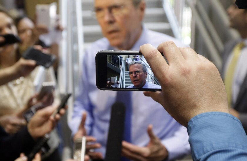 Former Florida Gov. Jeb Bush is photographed by an employee at Emergent BioSolutions, Thursday, May 28, 2015, in Lansing, Mich. Bush is also scheduled to deliver remarks at the Clinton County Republican Party and Ingham County Republican Party joint Lincoln Day Dinner. (AP Photo/Carlos Osorio)
