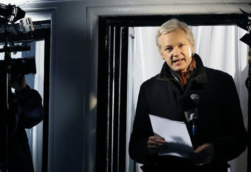 FILE - This is a Thursday, Dec. 20, 2012. file photo of Julian Assange, founder of WikiLeaks as he speaks to the media and members of the public from a balcony at the Ecuadorian Embassy in London. Assange has asked Swedish police to investigate what happened to a suitcase he suspects was stolen from him when he traveled from Sweden to Germany in 2010. Assange's lawyer, Per Samuelson, says he filed a criminal complaint with an affidavit by Assange to police at Stockholm's Arlanda Airport on Tuesd