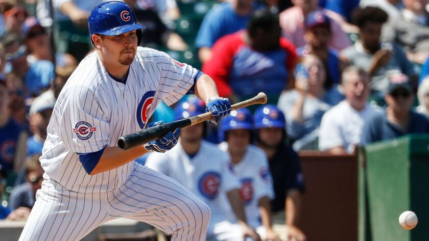 The Cubs' Trevor Cahill hits a sacrifice bunt off of Milwaukee Brewers' Matt Garza during the fourth inning of a baseball game Tuesday, Aug. 16, 2016, at Wrigley Field in Chicago.