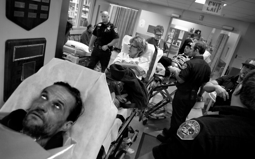 """The entrance to the emergency room at UCSD Medical Center in Hillcrest is jammed with returning patients. A man suffering schizoaffective disorder had run out of his medication. A woman who visited the ER that morning after a car crash, later collapsed in a parking lot and returned. An intoxicated man, cared for hours earlier, called 911 in search of painkillers and food. This situation is common, yet doctors and nurses have to take time to treat each patient. """"No one wants to be held accountable for a wrongful death,"""" said Dr. James Dunford, the city's medical director and a UCSD doctor."""
