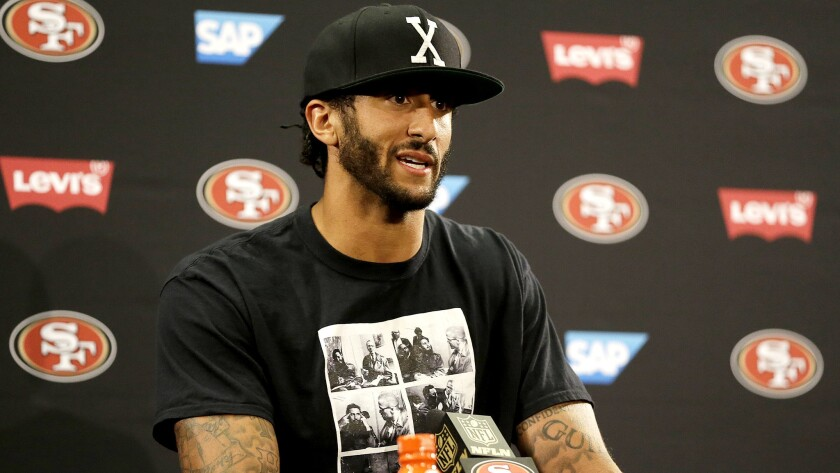 49ers quarterback Colin Kaepernick addresses the media after a preseason game against the Packers.