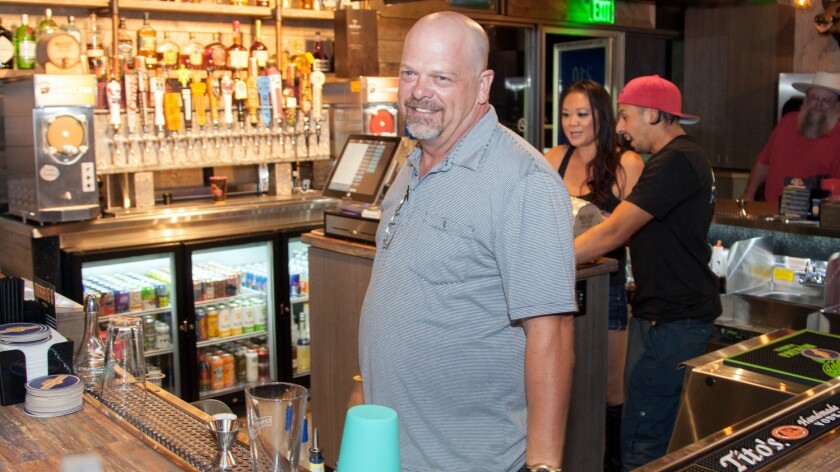 """Rick Harrison of """"Pawn Stars"""" plays celebrity bartender at his new BBQ restaurant in Las Vegas."""