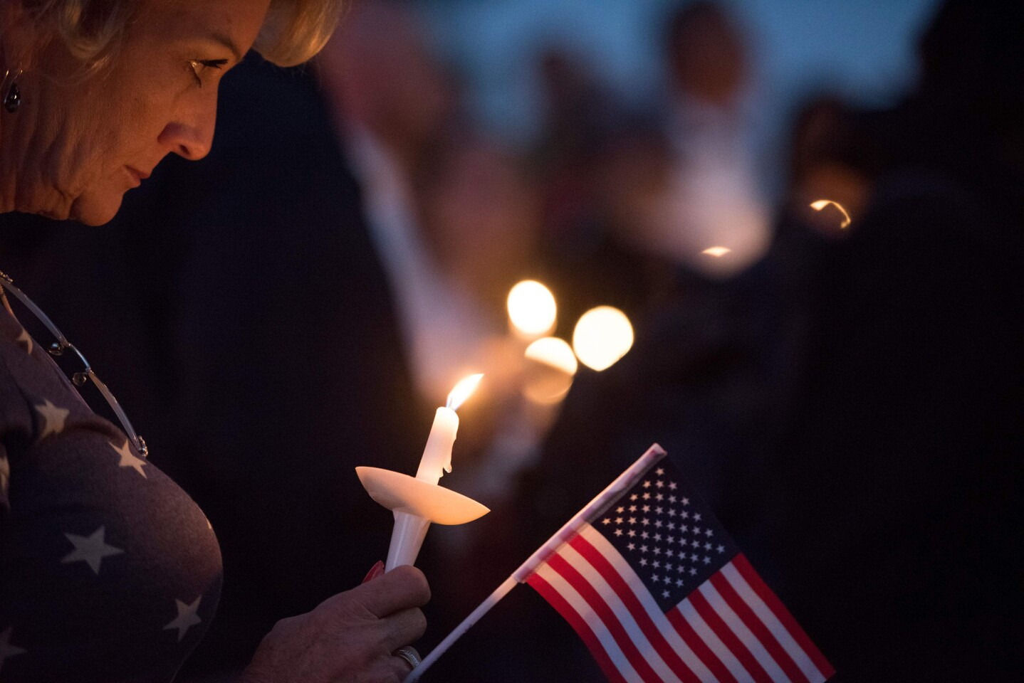 People attend a memorial for Las Vegas Police Officer Charleston Hartfield at Police Memorial Park. Hartfield, who was off duty at the music festival, was killed when Stephen Paddock opened fire.