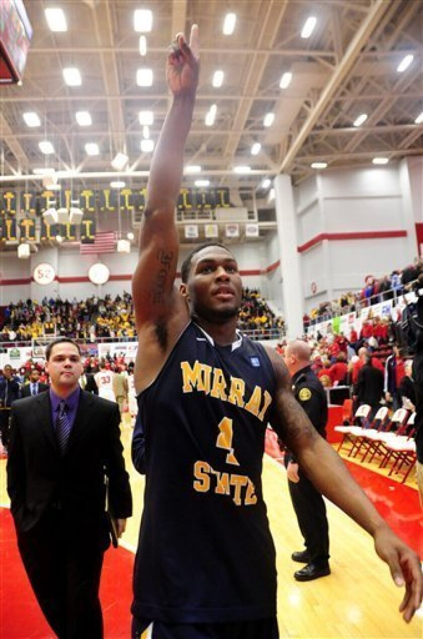 Murray State guard Latreze Mushatt (4) gestures to the crowd after defeating Austin Peay 87-75 in an NCAA college basketball game on Saturday, Jan. 7, 2012, in Clarksville, Tenn. (AP Photo/Mike Strasinger)