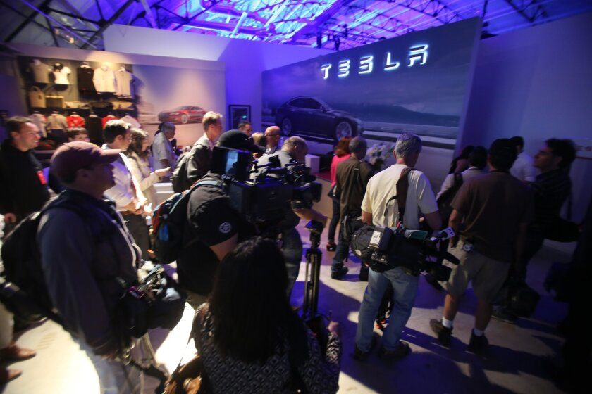 Media members line to enter Tesla Design Studio to wait for Tesla Motors Inc. to announce its expansion into the home battery market in Hawthorne, Calif., Thursday, April 30, 2015. Tesla CEO Elon Musk is trying to steer his electric car company's battery technology into homes and businesses as part