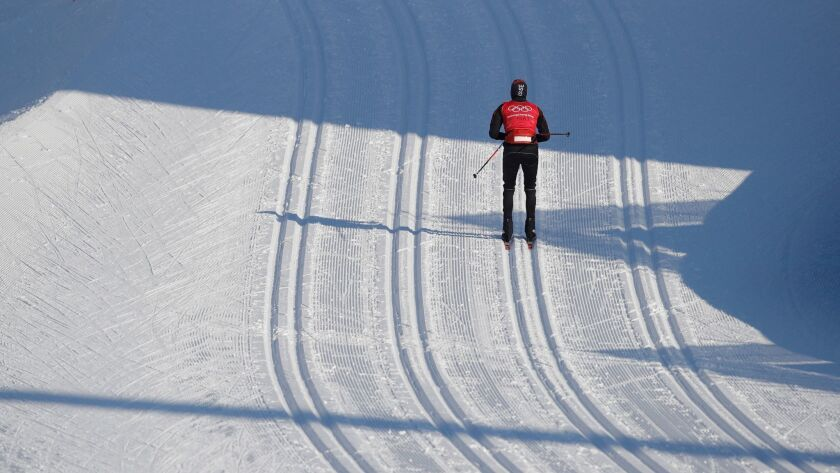 A solitary athlete trains ahead of the Pyeongchang Olympics at Alpensia Cross-Country Skiing Centre.