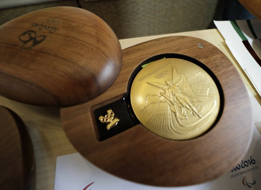A Rio 2016 Olympic gold medal is displayed at the Olympic Park Wednesday, July 20, 2016, in Rio de Janeiro. There's no such thing as a �gold� medal, not at these upcoming Rio Olympics, and really, not ever. Second-place finishers get silver medals and oddly enough, so do the winners, albeit theirs