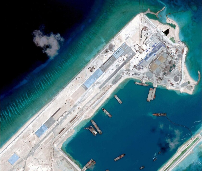 A satellite photo taken on April 2, 2015, shows an air strip that China is building on reclaimed land in the South China Sea, according to researchers at the Center for Strategic and International Studies.
