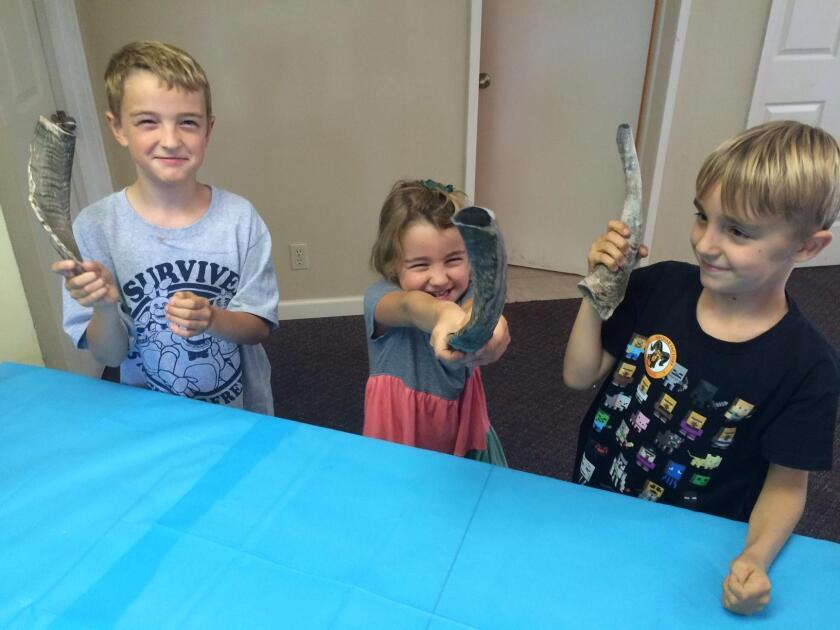 Kids show off their shofars.