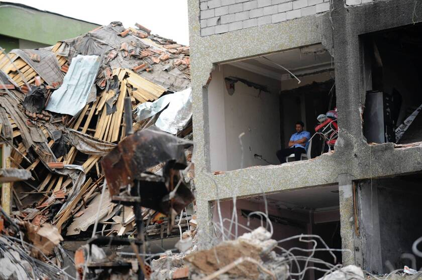 Many buildings were left with heavy damage after twin bombings on May 11 ripped through a section of Reyhanli, Turkey, near the border with Syria.