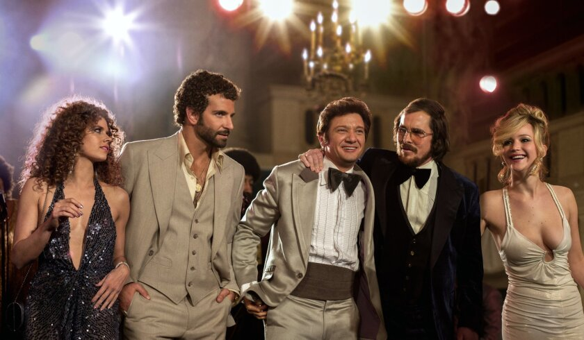 """This film image released by Sony Pictures shows, from left,  Amy Adams, Bradley Cooper, Jeremy Renner, Christian Bale and Jennifer Lawrence in a scene from """"American Hustle."""" The film received 13 nominations for the Broadcast Film Critics Association's 19th Annual Critics' Choice Movie Awards airin"""