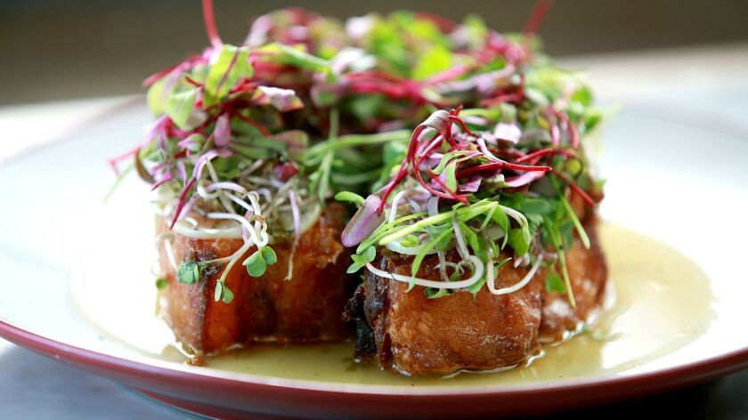 Chicharron with elephant garlic mojo, radish sprout and picked herbs from Broken Spanish.