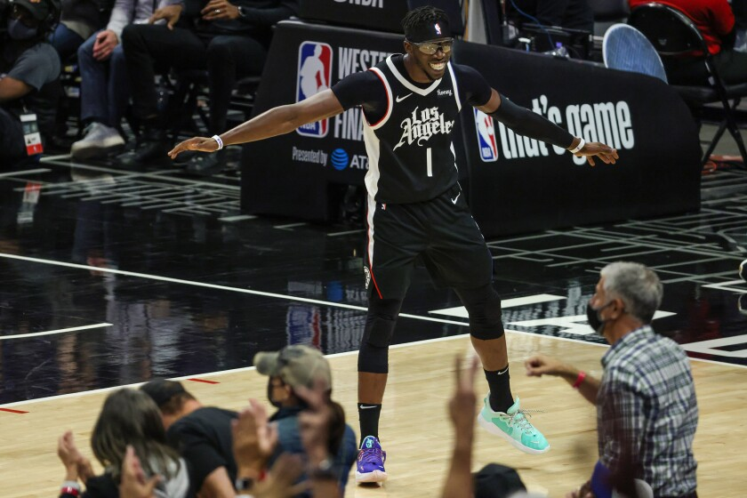 Clippers guard Reggie Jackson celebrates with fans after hitting a three-pointer late in Game 3.