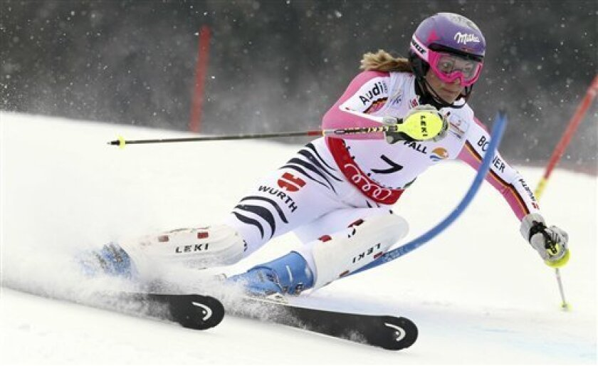 Germany's Maria Hoefl-Riesch clears a gate during the first run of the women's slalom, at the Alpine skiing world championships in Schladming, Austria, Saturday, Feb.16, 2013. (AP Photo/Alessandro Trovati)