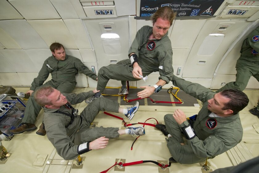 Dr. Paddy Barrett (front left) of the Scripps Translational Science Institute and his research associates tested a wireless vital signs device during a NASA flight that simulated zero gravity. Courtesy photo