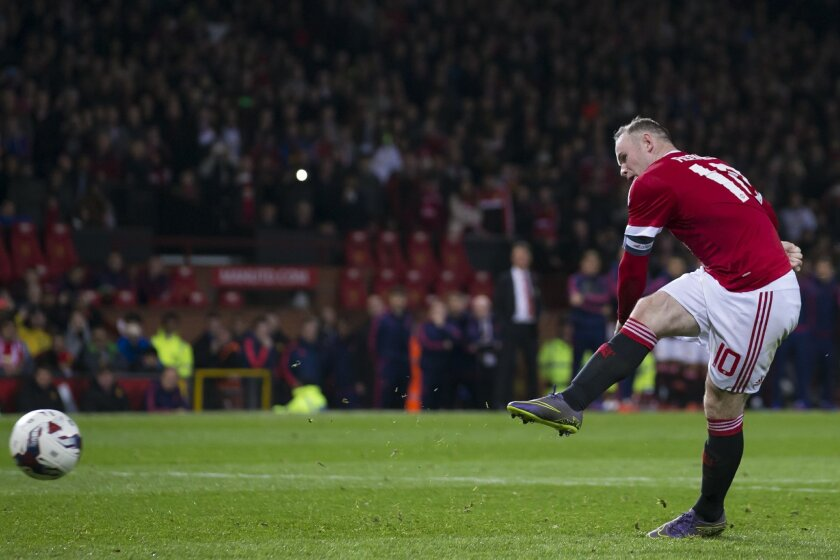 In this picture taken on Wednesday Oct. 28, 2015, Manchester United's Wayne Rooney takes a penalty during the English League Cup soccer match berween Manchester United and Middlesbrough at Old Trafford Stadium, Manchester, England. The Football Association is investigating claims that a laser was s