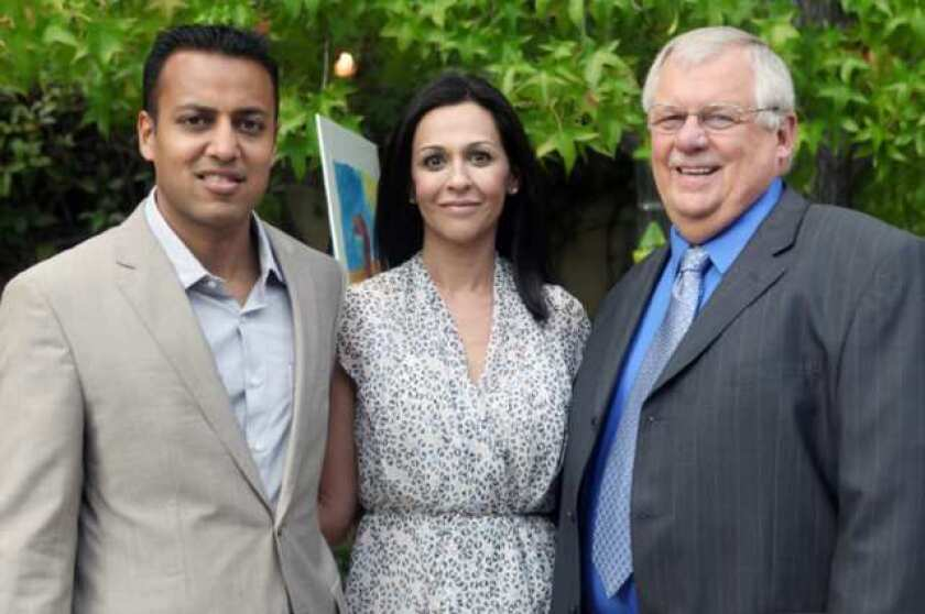 Neil and Sonia Singla talk with Bill Martone, Hathaway-Sycamores president and CEO.Neil and Sonia hosted the reception honoring Tim and Kathy MacDonald at their Pasadena home. (Photo by Orly Olivier)