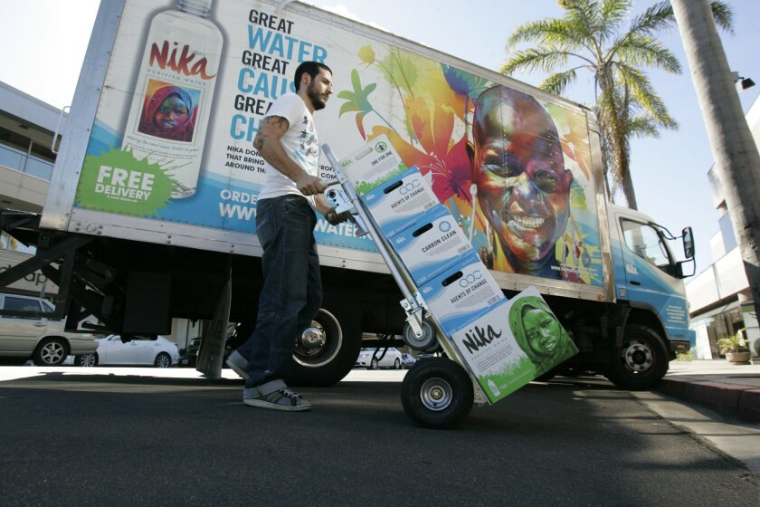 Jordan Mellul, general manager of Nika Water, loads his box truck and delivers water from the Miramar warehouse to a location in La Jolla.
