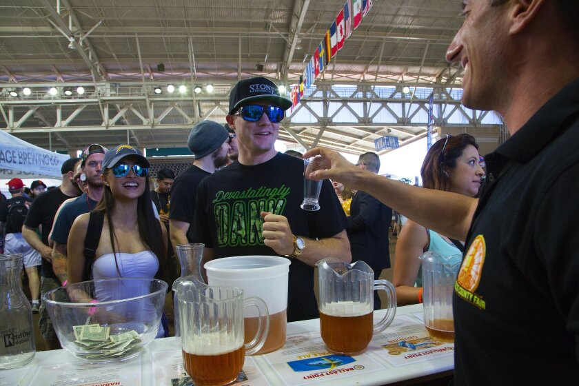 Cassandra Ferrier and Sean Bell prepare to sample craft beers at the Saturday's International Beer Festival held at the San Diego County Fair.