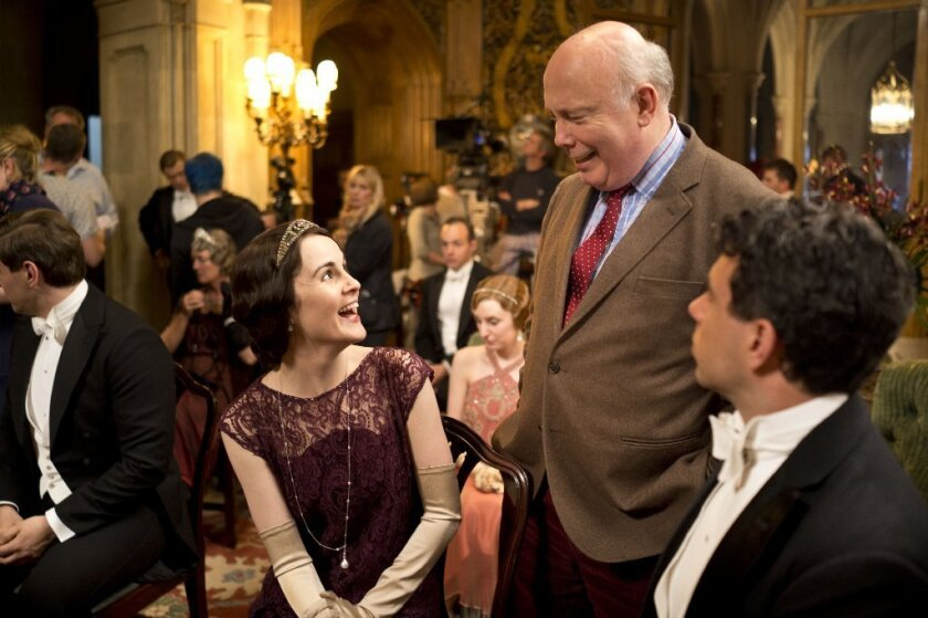 Show creator Julian Fellowes with Michelle Dockery, who plays Lady Mary, on the set of Downton Abbey, season 4.