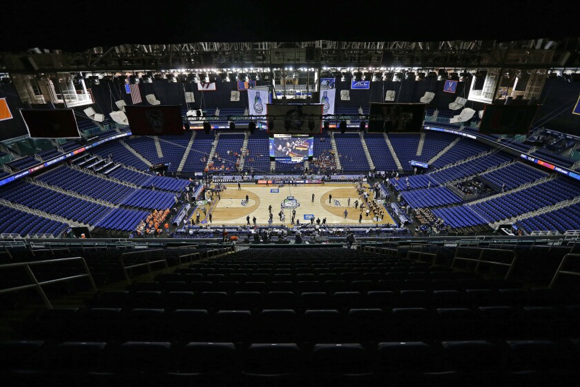 Greensboro Coliseum is mostly empty after games were canceled at the Atlantic Coast Conference tournament in Greensboro, N.C., on Thursday.