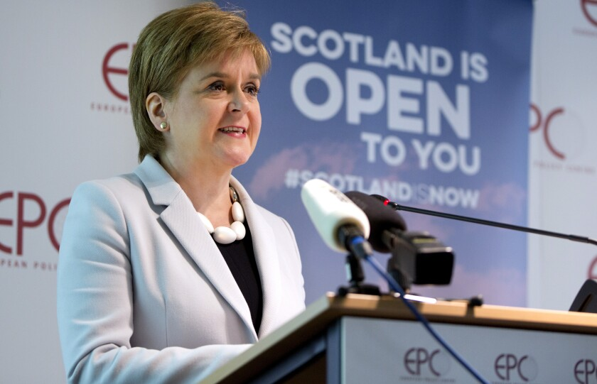 FILE - In this Tuesday, June 11, 2019 file photo, Scotland's First Minister Nicola Sturgeon speaks during an event in Brussels. Scotland's pro-independence leader said Monday, Nov. 30, 2020 that she hopes to hold a referendum on independence from Britain as early as next year, setting up a political showdown with a U.K. government that refuses to countenance a secession vote. (AP Photo/Virginia Mayo, file)