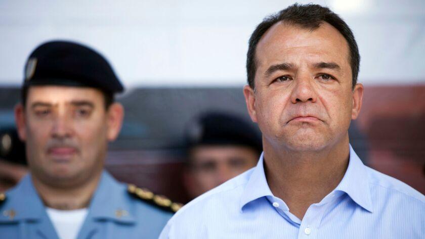 FILE - In this April 18, 2012 file photo, Rio de Janeiro Gov. Sergio Cabral, right, attends the inau