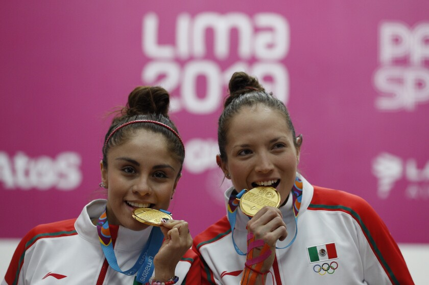 Mexico's Paola Longoria, left, and Samantha Salas pose with their gold medals for women's team racquetball at the Pan American Games in Lima, Peru, Wednesday, Aug. 7, 2019. (AP Photo/Rebecca Blackwell)