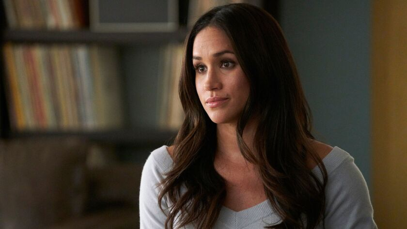 """In this image released by USA Network, Meghan Markle appears in a scene from """"Suits."""" Show creator a"""