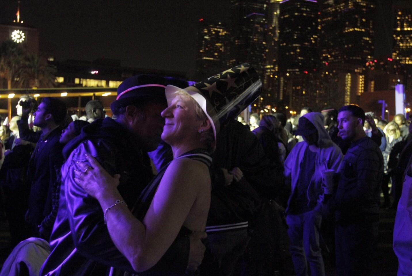 Cheryl Willard and partner Alex Gantz dance at Grand Park on New Year's Eve.