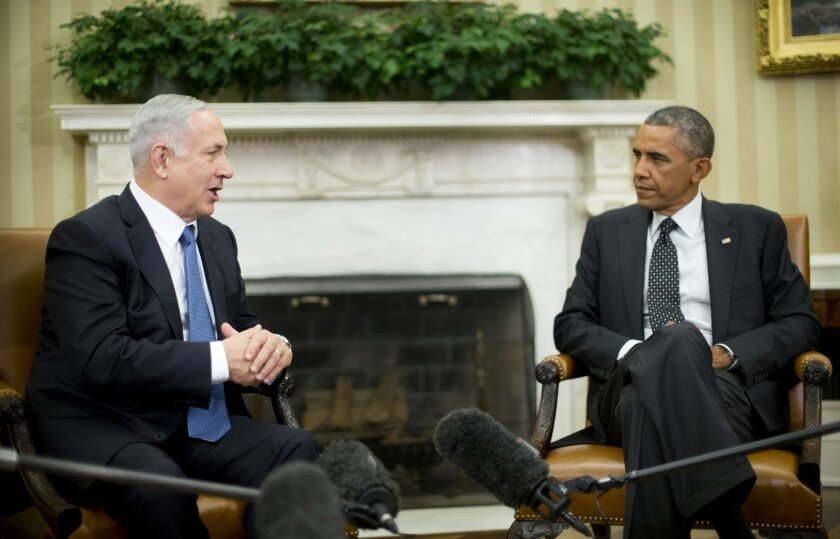 FILE - In this Oct. 1, 2014 file photo, President Barack Obama meets with Israeli Prime Minister Benjamin Netanyahu in the Oval Office of the White House in Washington. President Barack Obama does not intend to be silent or out of sight when Netanyahu addresses Congress in a visit that was arranged by Speaker John Boehner behind the administration's back. The breach of protocol has grown to what seems like a grudge match between two men who dislike each other. Vice President Biden will be out of town during Netanyahu's speech, leaving an empty chair behind the Israeli leader's podium and Secretary of State John Kerry may conveniently find a foreign trip to be on that day as well. (AP Photo/Pablo Martinez Monsivais, File)