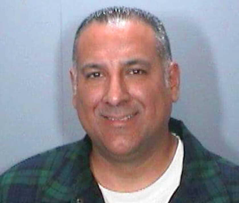 Booking photo released by the Orange Police Dept. shows Los Angeles Police Officer Matthew Calleros.