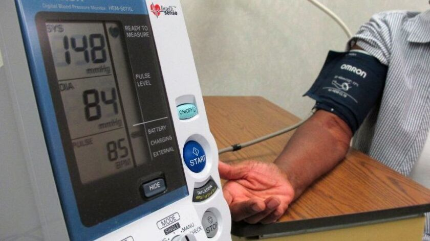 A woman has her blood pressure checking at the Wake Forest Baptist Medical Center in Winston-Salem, N.C., in July.
