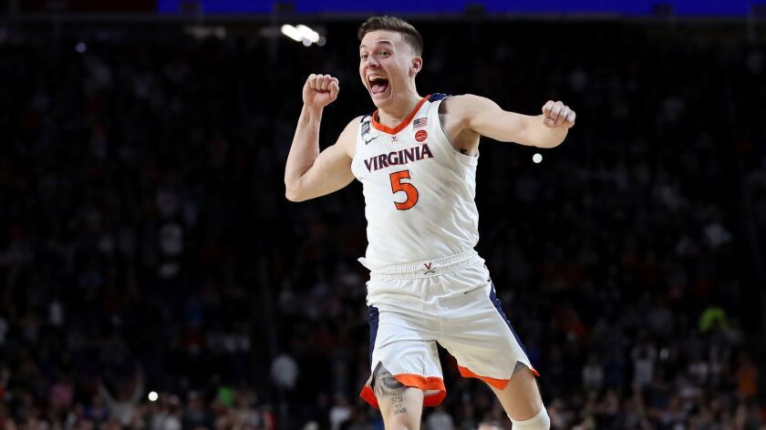 Virginia's Kyle Guy celebrates the Cavaliers' 85-77 win over Texas Tech in the NCAA men's basketball championship game on Monday.