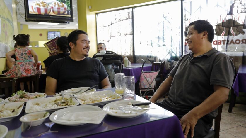 LOS ANGELES, CA -- OCTOBER 26, 2018: Eamon Ore-Giron, left, chats with Intiraymi owner Fabian Nahui