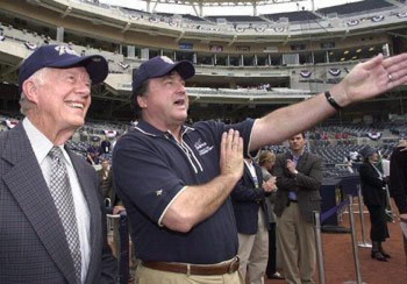 Padres owner John Moores gave former president Jimmy Carter a tour of Petco Park on opening day.