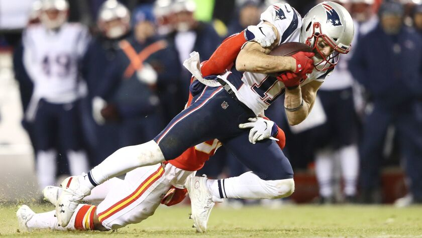 New England Patriots wide receiver Julian Edelman makes a catch in overtime against the Kansas City Chiefs during the AFC championship game on Sunday.
