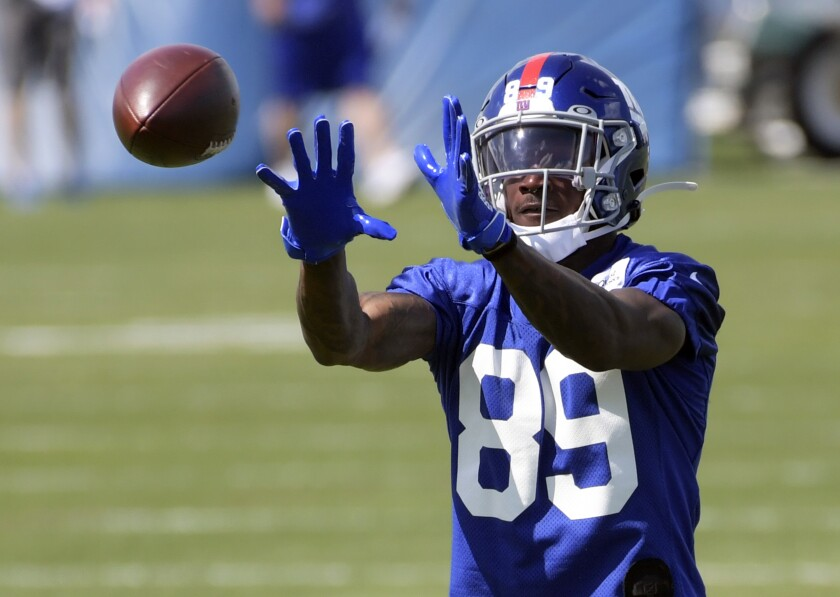 FILE - In this May 14, 2021, file photo, New York Giants first-round draft pick Kadarius Toney catches a pass during NFL football rookie minicamp in East Rutherford, N.J. The New York have completed signing their draft picks, getting first-round pick Kadarius Toney under contract on Friday, June 4, 2021. (AP Photo/Bill Kostroun, File)