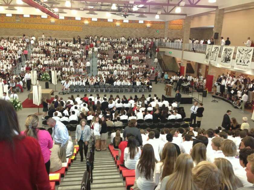 Students, faculty and parents gathered at Cathedral Catholic High School Tuesday to offer prayers for  the family injured in a crash on state Route 52.