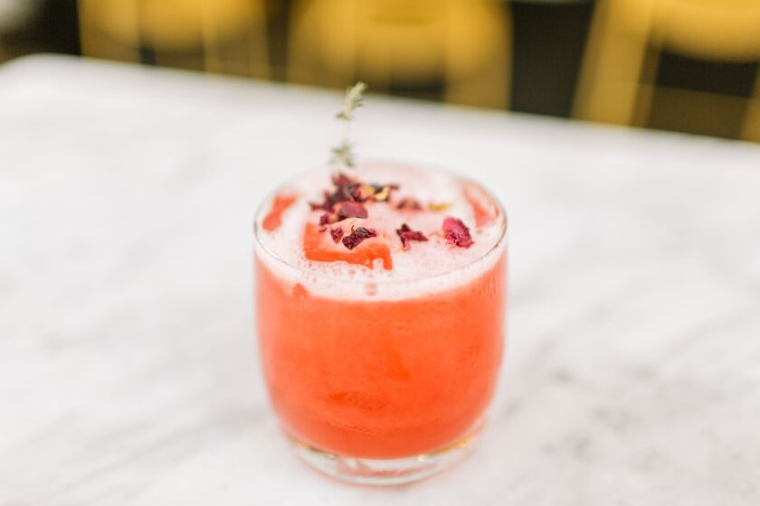 True Food Kitchen's Juniper Rose cocktail, with rose-infused gin, lime, grapefruit and thyme, makes for a festive holiday shopping de-stresser.