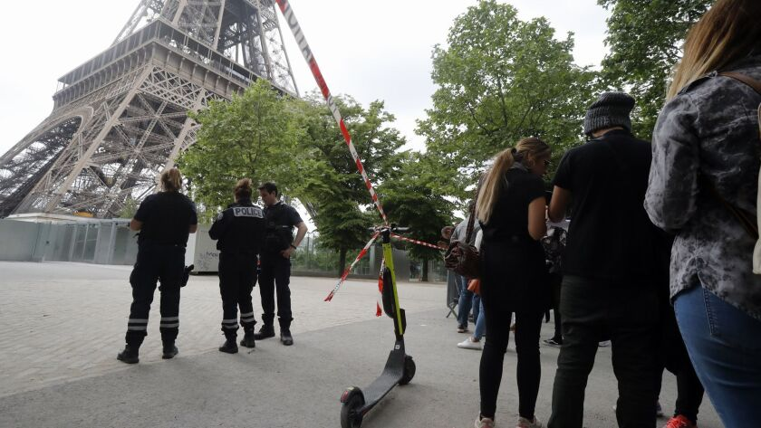 Police prevent tourists from entering the area of the Eiffel Tower Monday, May 20, 2019 in Paris. Th