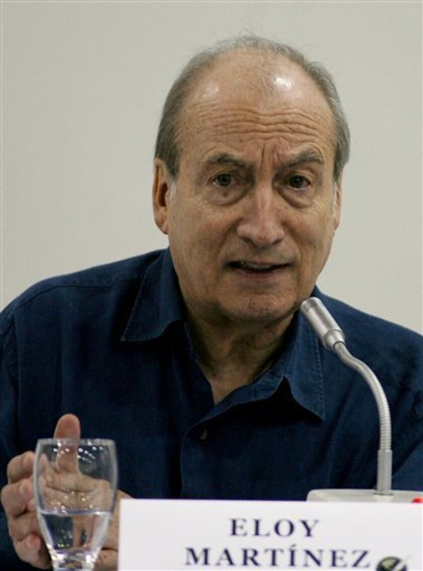 In this file photo, Tomas Eloy Martinez speaks during the 63rd Inter American Press Association meeting in Cartagena, Colombia, Sunday, March 18, 2007. Martinez died of cancer on Jan. 31st, at the age of 75. (AP Photo/ William Fernando Martinez, File)