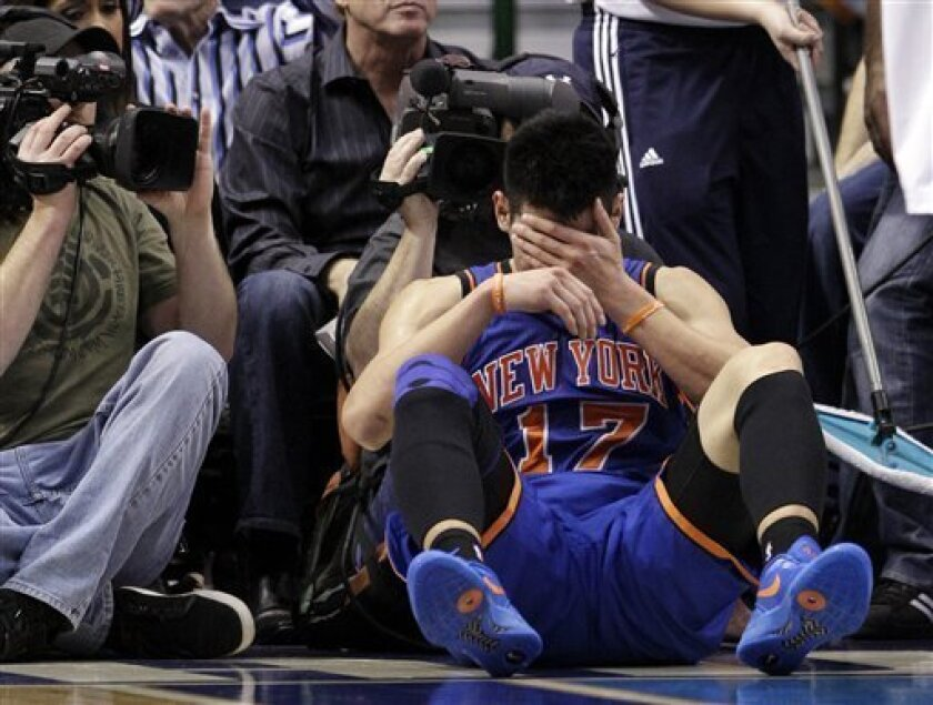FILE - In this March 6, 2012, file photo, New York Knicks' Jeremy Lin reacts after being fouled during an NBA basketball game against the Dallas Mavericks in Dallas. Lin is having left knee surgery and will miss six weeks, likely ending his amazing breakthrough season.  The team said Saturday, Marc