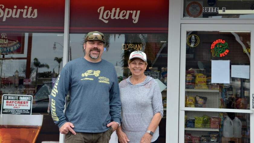 Bryan Nye and his mother, Sylvia Bice, who own Baycrest Caps & Corks Bottle Shop and Market in Costa Mesa, have expanded their grocery offerings in response to the coronavirus outbreak.