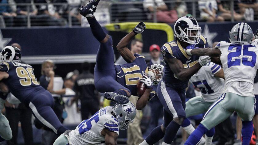 ARLINGTON, TEXAS, SUNDAY, OCTOBER 1, 2017 - Rams kick returner Pharoh Cooper is flipped by Cowboys s