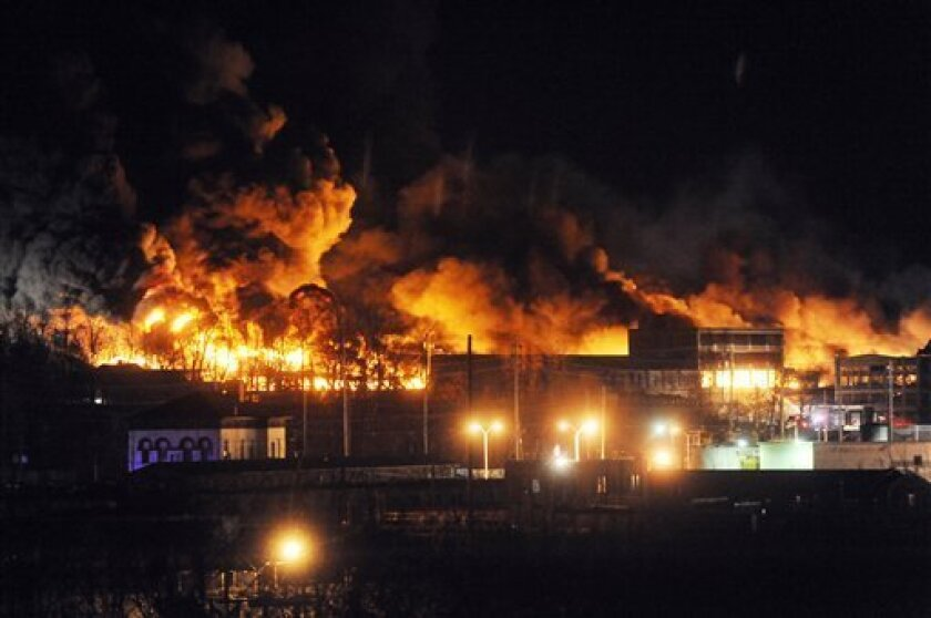 A fire burns at the former Westclox clock factory early Sunday, Jan. 1, 2012, in Peru, Ill. The fire began before midnight and was still burning Sunday morning, drawing firefighters from surrounding northern Illinois communities to help out and leading to the mandatory evacuation of residents from nearby homes early Sunday. (AP Photo/NewsTribune, Amanda Whitlock) MANDATORY CREDIT