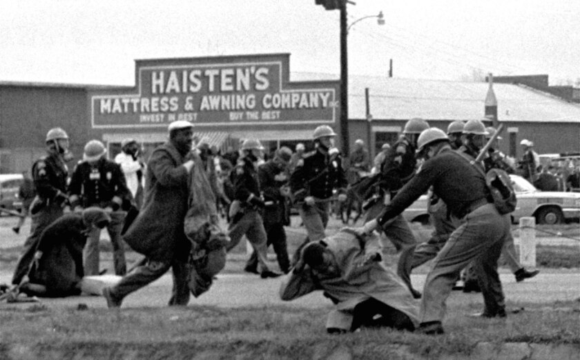 March 7, 1965: Alabama state troopers use clubs against participants of a civil rights voting march in Selma, Ala.