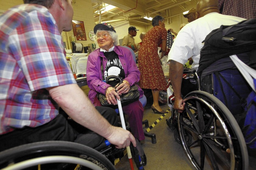 Bea Abrams Cohen speaks with Marine veteran Larry Foster, left, in North Hills in 2012. Cohen, a World War II veteran who spent more than 70 years supporting U.S. military organizations and charities, has died at the age of 105.